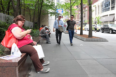 Woman sat checking her phone