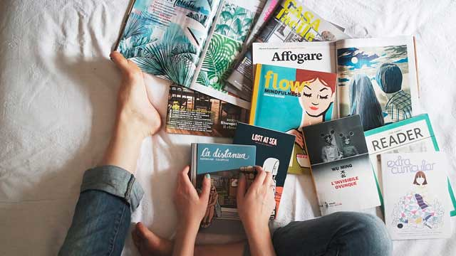 reading magazines on bed