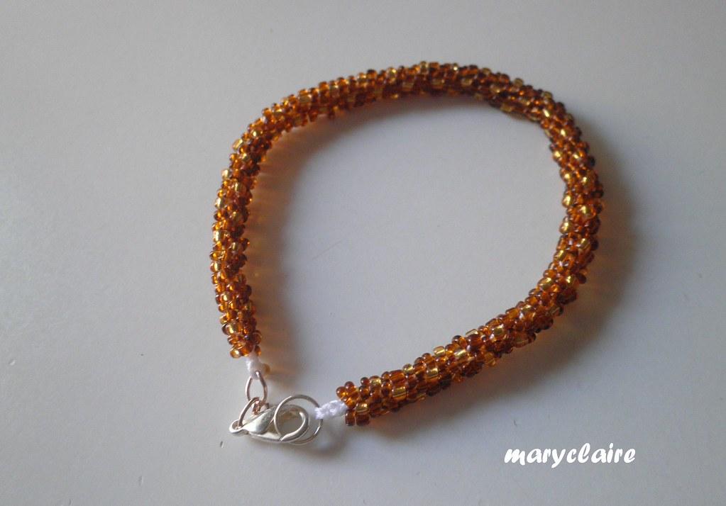 braccialetto marrone e oro con gancetto 2