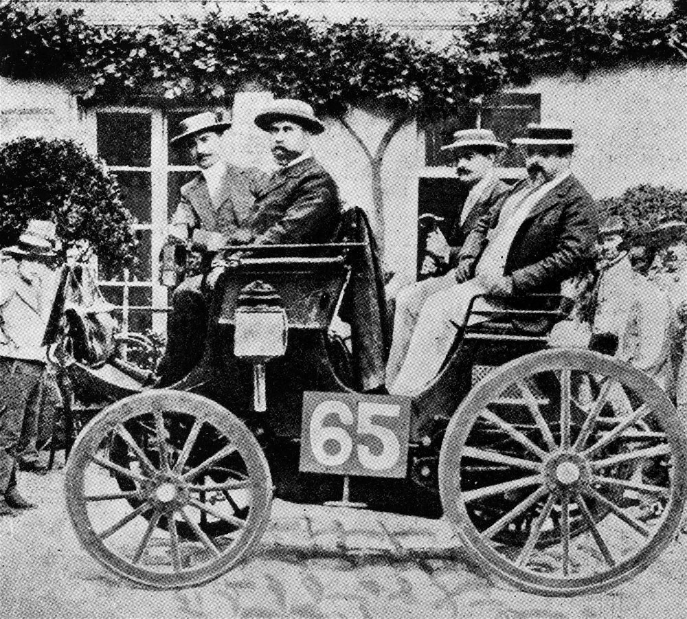 The Peugeot from Albert Lemaître (starting number 65 in the first car race, held from Paris to Rouen on July 22, 1894), pictured on the left-hand rear seat is Adolphe Clément. The Peugeot with an engine manufactured under licence from Daimler was the first vehicle with a combustion engine to finish the race, crossing the line in second place.