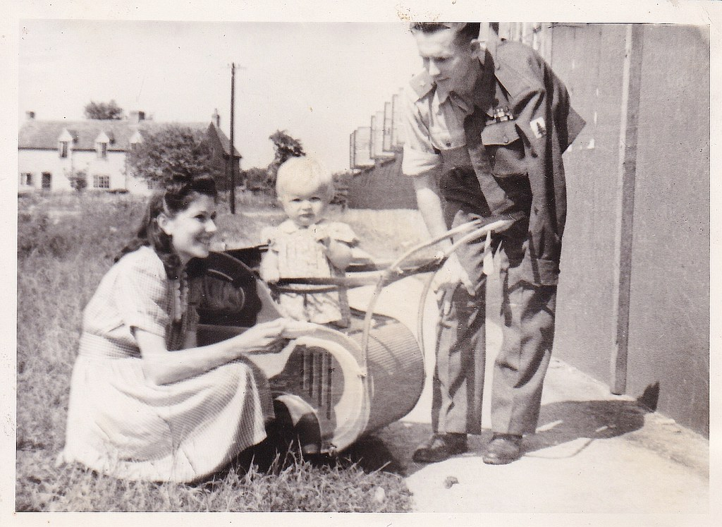 Basia Klimas-Sawyer with parents in Rivenhall camp, 1947