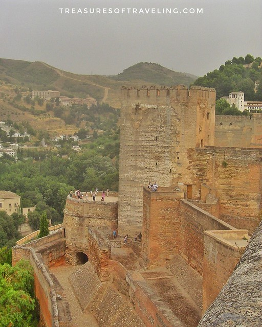 Looking down onto the walls of the Alhambra, a palace and fortress complex located in Granada, Spain. The architecture, the gardens and the backdrop of the Sierra Nevada Mountains in the background make this fortress a Spanish treasure! This is just one o