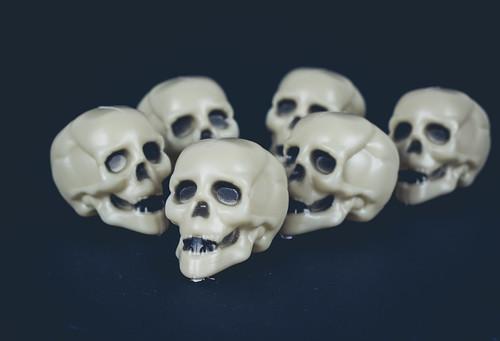 Skulls on dark background