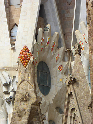 an image shoeing the detailed architectural appendages designed around one of the windows of the Sagrada Familia designed by Gaudí in Catalonia, Spain