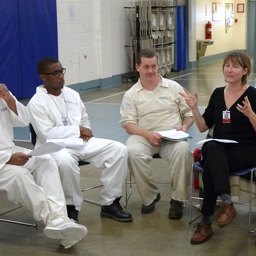 Morgan Leyenberger leading a conflict resolution class at a prison unit in Arkansas