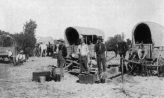 Waiting for the opening of the Cherokee Strip (or Outlet) at a camp near Arkansas City, Kansas. Photo taken by Walter D. Hutchison in September 1893.