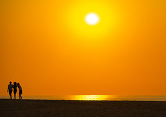 Silhouettes of women at sunset on a beach, Benguela Province, Lobito, Angola