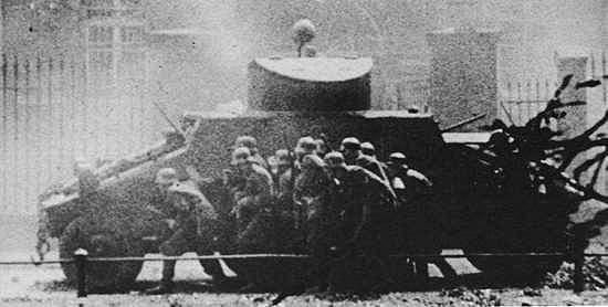 SS soldiers attacking the Polish Post Office in Danzig under cover of ADGZ vehicle on September 1, 1939.