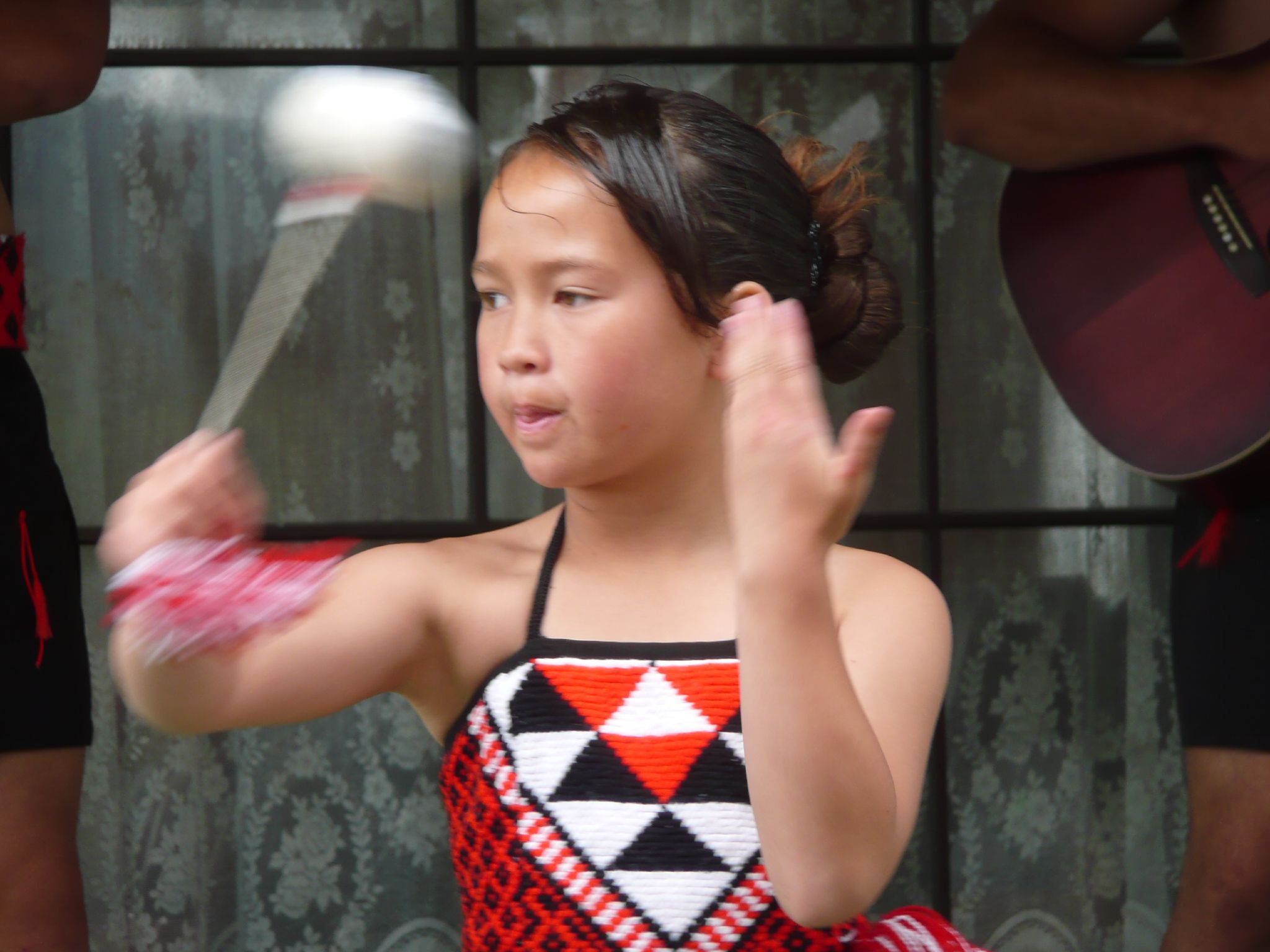 Young Maori girl in traditional dress dancing a poi. Photo taken on December 1, 2007.