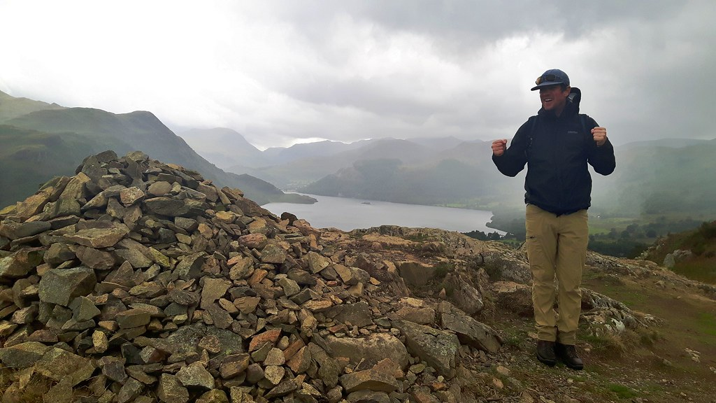 Terry and cairn on top of hill overlooking Ullswater, England