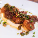 Cornmeal Fried Oysters, sun dried tomatoes, caper tapenade, lemon garlic aioli