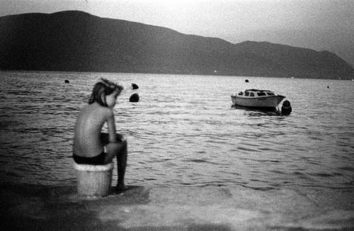 montenegro rose kotor bay water sea boat mountain child blur waiting sunset