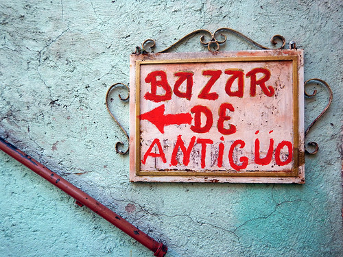 A Bazar de Antiguo sign on a turquoise wall in Puebla, a UNESCO Heritage site in Mexico