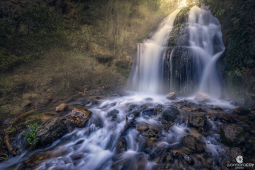The first rays of sunshine light up the Bravo stream waterfall. Natural Park