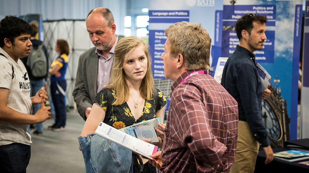 Prospective students speaking to academic staff
