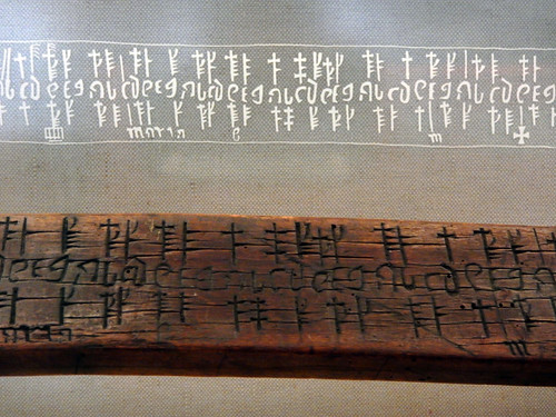 A wood marker with ancient Viking runes on it at the National History Museum in Copenhagen, Denmark