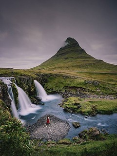 Kirkjufell, or 'Church Mountain', is a distinctly shaped peak found on the north shore of Iceland's Snæfellsnes Peninsula, only a short distance away from the town of Grundarfjörður. It is often called 'the most photographed mountain in Iceland', due to i