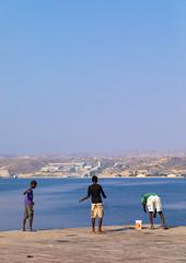 Men fishing on the jetty, Benguela Province, Lobito, Angola