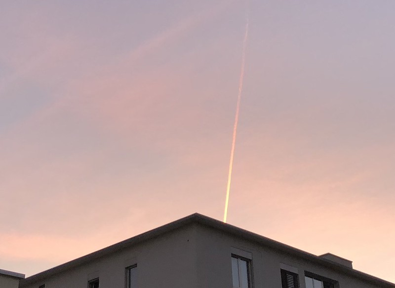 Evening plane in sunset