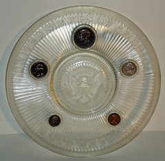 Glass plate with embedded 1964 coins