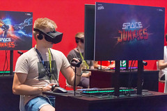 Gamer playing Space Junkies with VR headset and controller