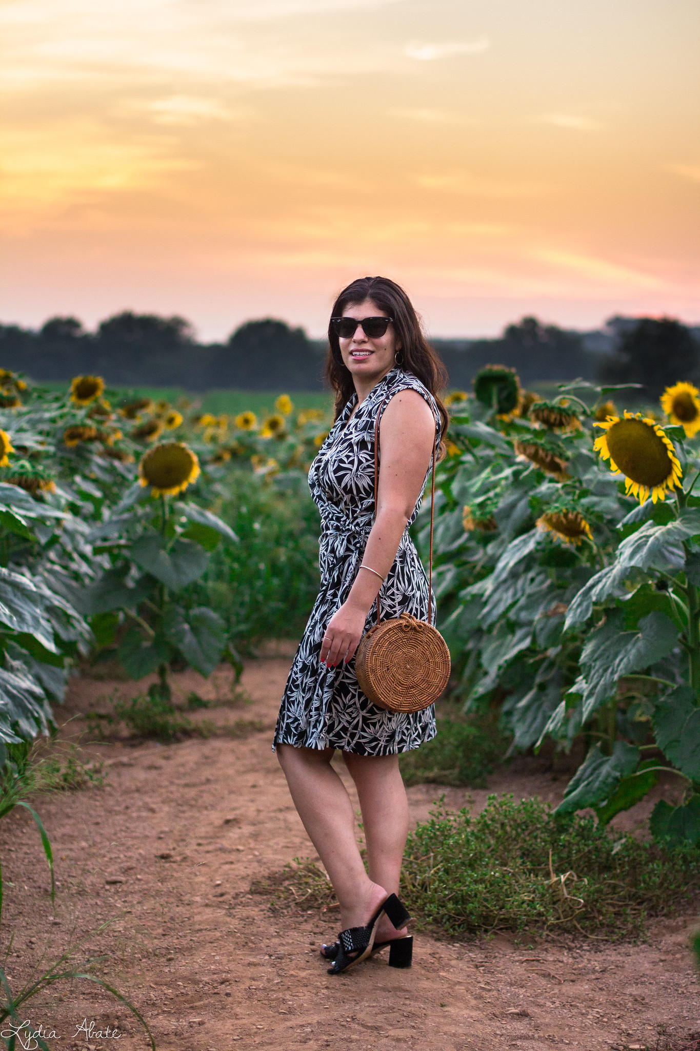 bamboo print wrap dress, woven black mule sandals, round rattan bag, sunflower field-7.jpg