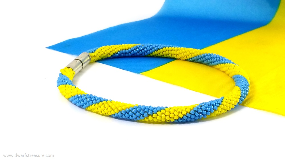 Graceful blue and yellow glass bead crochet bracelet