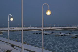 Winter sea. Harbor.