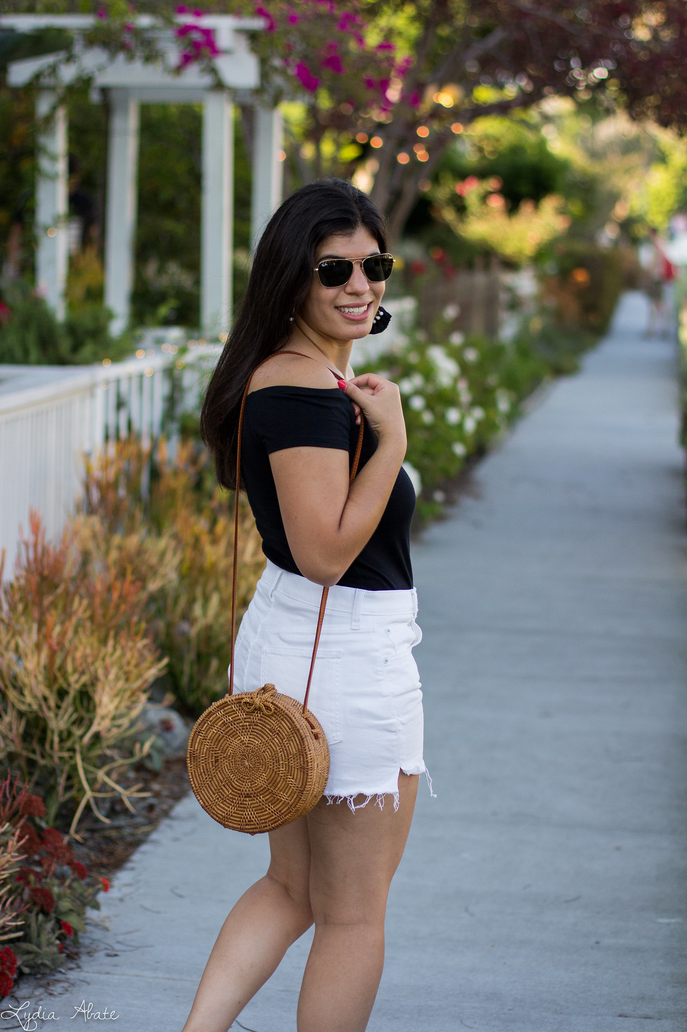 black off the shoulder top, round rattan bag, white button fly shorts-1.jpg