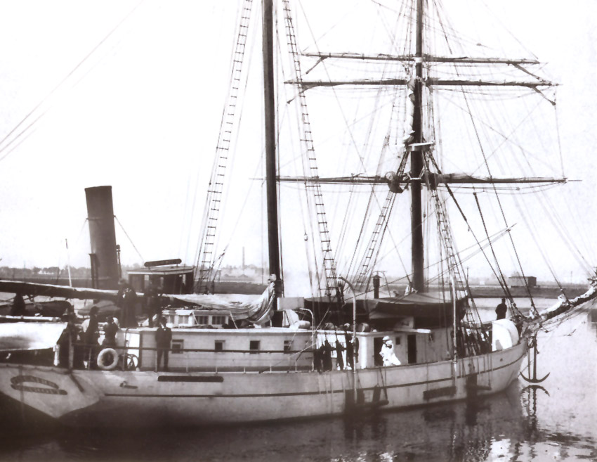 The Pitcairn tied up to another vessel at the docks in Oakland, California, circa 1893.