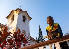 Angolan boy in front of igreja da arrábida, Benguela Province, Lobito, Angola