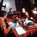 Pilots of the SR-71 Blackbird assigned to the 9th Strategic Reconnaissance Wing, discuss flight details during breakfast. Their aircraft will be refueled by a KC-10 Extender in flight during testing. (Courtesy photo/9th Reconnaissance Wing)