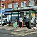 Ladies at a bus stop, Kingsbury, NW London