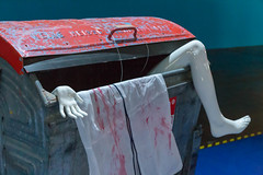 Corpse in a garbage container