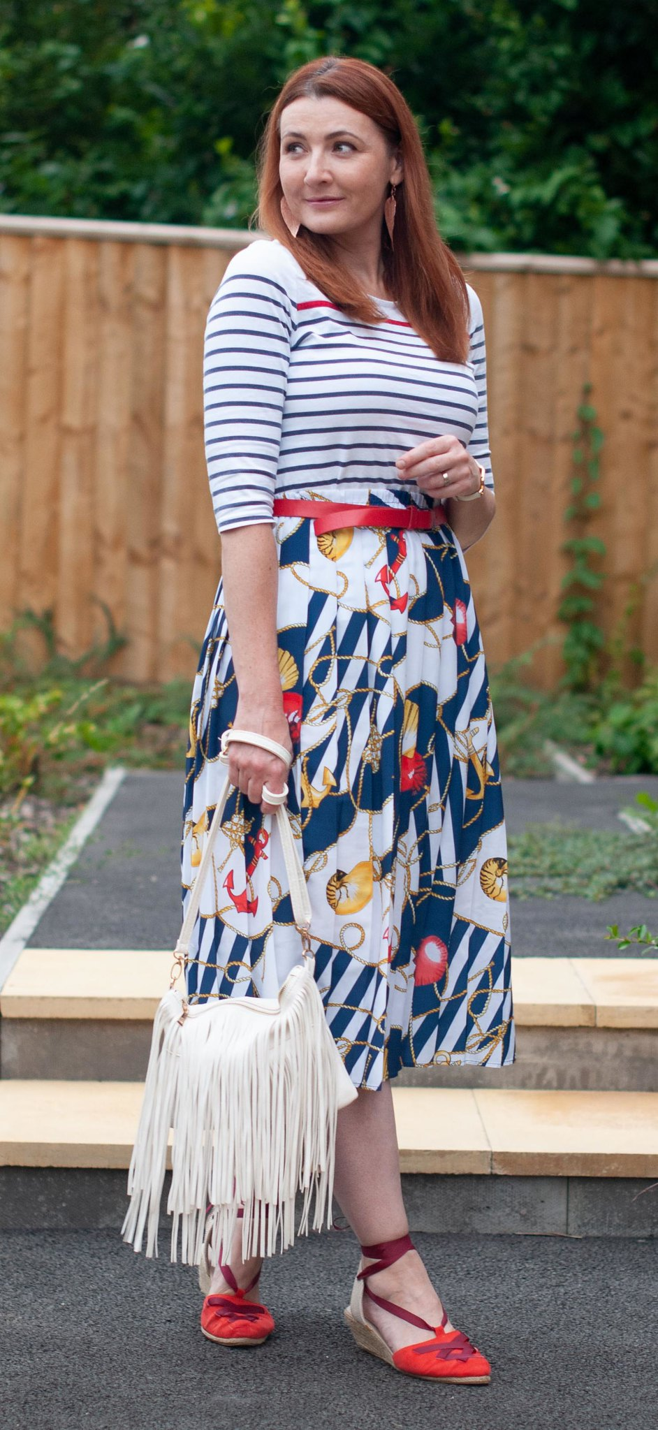 How to Wear a Vintage Nautical Look, Over 40 Style \ stripe Breton top \ vintage nautical print pleated midi skirt \ red espadrilles \ white fringe bag | Not Dressed As Lamb, over 40 fashion
