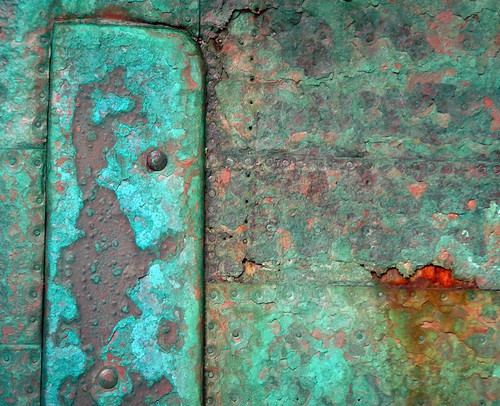 The copper verdigris cladding of the frigate in Ebeltoft, Denmark