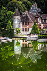 reflections of Château de Boutemont in its ornamental pond (a very large pond!), Ouilly-le-Vicomte, Calvados, Normandy, France - Photo of Saint-Hymer