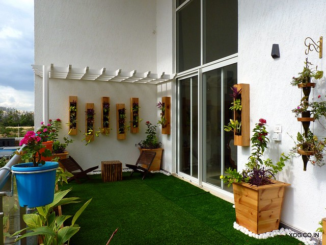 Villament garden with artificial grass and wooden deck tiles