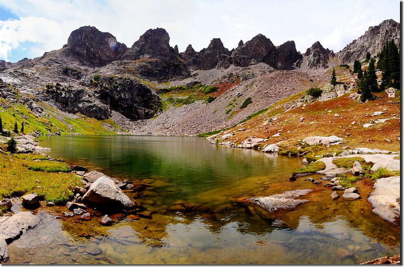 Glacier ground rock creates a greenish hue in Upper Willow Lake 1