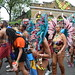 DSC_8462 Notting Hill Caribbean Carnival London Exotic Colourful Maroon Costume with Turquoise and Pink Ostrich Feather Headdress Girls Dancing Showgirl Performers Aug 27 2018 Stunning Ladies