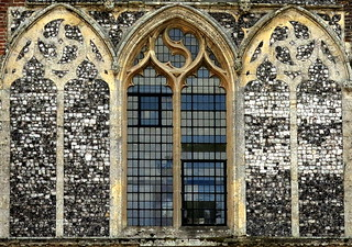 Two sham windows filled with flushwork flank a glazed one: Butley Priory gatehouse (14th C.), Suffolk, England