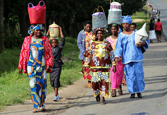 Rwandan women walking along  the road