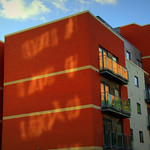 Sunlit reflections on a building in Preston