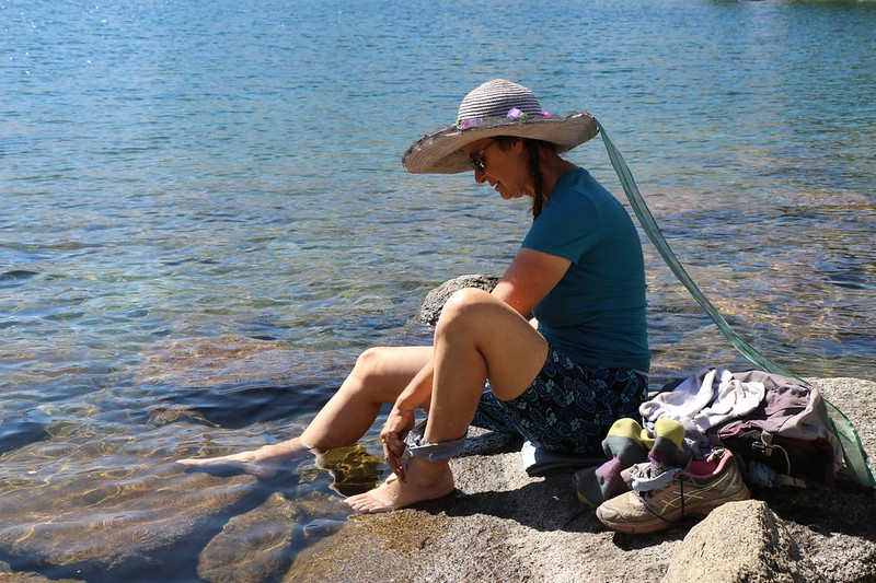 Vicki cooling her hot feet in Fontanillis Lake on the Pacific Crest Trail - I did it too!