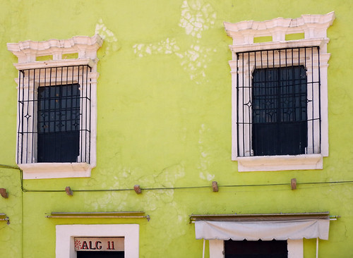 A bright lime green wall in Puebla, a UNESCO Heritage site in Mexico