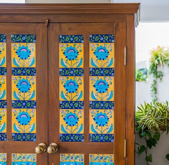 Tile inlay in a refurbished wooden cupboard