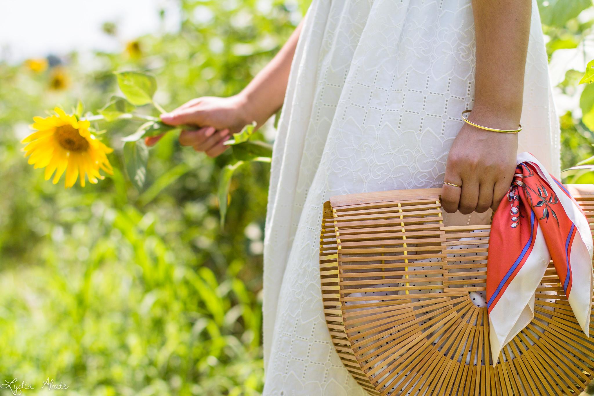 white eyeelt dress, bamboo bag, sunflower field-15.jpg
