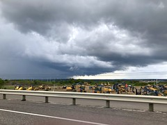 Storm Clouds and Construction Vehicles