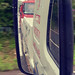 View From Passenger Side Mirror Of Wrecker Whilst Towing Tanker