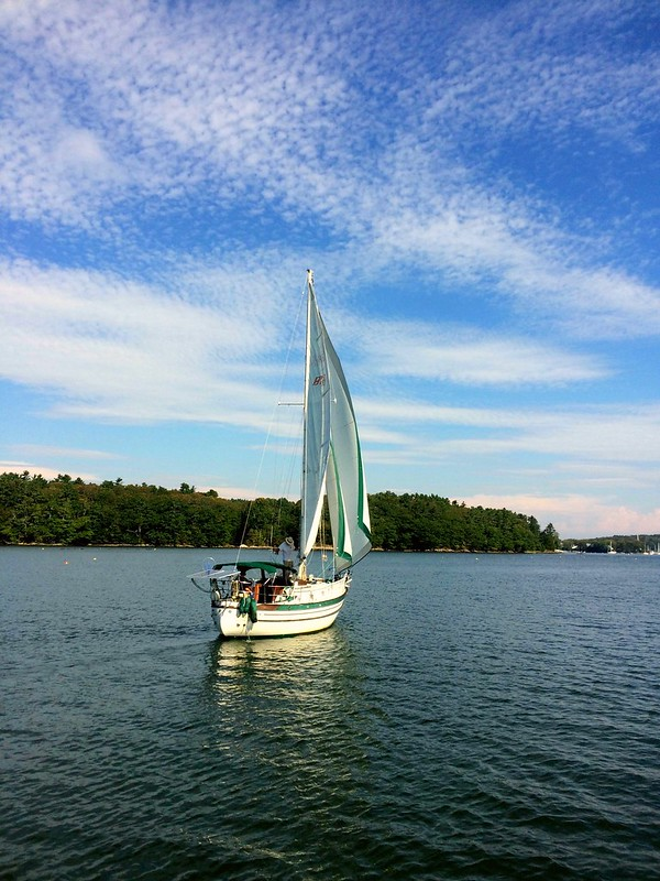 Photo by Kris Ashby: American Author Dena Hankins and James Lane sail away on S/V S.N. Cetacea.